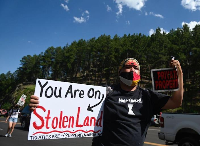 Activists and members of different tribes from the region protest in Keystone, South Dakota, on July 3, 2020, during a demonstration around the Mount Rushmore National Monument and the visit of then-President Donald Trump. (Andrew Caballero-Reynolds Getty Images)