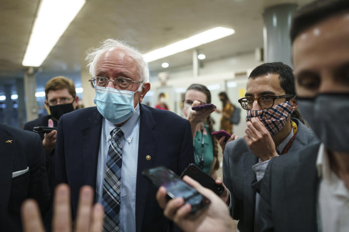 Sen. Bernie Sanders, I-Vt., chair of the Senate Budget Committee, is met by reporters during the vote to start work on a nearly $1 trillion bipartisan infrastructure package, at the Capitol in Washington, Wednesday, July 28, 2021.  (J. Scott Applewhite/AP)