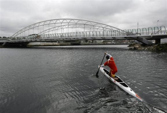 Spain's David Cal paddles his canoe single (C1) during a training session on the River Lerez in the city of Pontevedra May 17, 2012. Cal is months away from a shot at winning a fifth Olympic medal, which would make him Spain's most decorated Olympian. The man who had the honor of carrying the Spanish flag at the opening ceremony in the Beijing Olympics competes in the C1 class canoe, where the competitor kneels in his craft and uses a single paddle down one side.