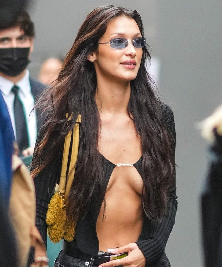 """SAINT-DENIS, FRANCE – JUNE 30: Bella Hadid wears a black ribbed opened cardigan, a yellow fluffy bag, a Fendi belt, during Jacquemus """"La Montagne"""" Show, at La Cite Du Cinema on June 30, 2021 in Saint-Denis, France. (Photo by Edward Berthelot/Getty Images)"""