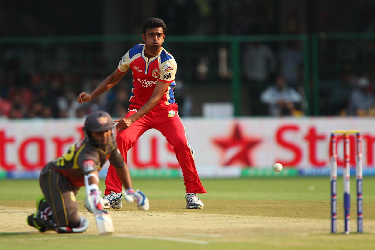 Jaidev Unadkat fields from his own bowling and tries to run out Parthiv Patel during match 9 of of the Pepsi Indian Premier League between The Royal Challengers Bangalore and The Sunrisers Hyderabad held at the M. Chinnaswamy Stadium, Bengaluru on the 9th April 2013. (BCCI)