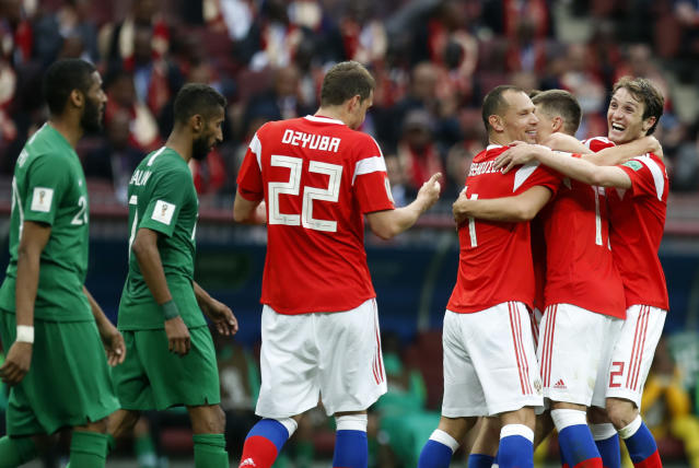 Russia's Alexander Golovin, second from right, celebrates with teammates, after scoring his side's fifth goal during the group A match between Russia and Saudi Arabia which opens the 2018 soccer World Cup at the Luzhniki stadium in Moscow, Russia, Thursday, June 14, 2018. (AP Photo/Pavel Golovkin)