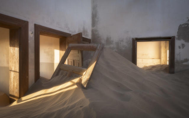 "<p>""The town of Kolmanskop was larger than I initially thought,"" Swindler says. ""Many of the buildings aren't full of sand."" (Photo: David Swindler/Caters News) </p>"