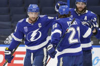 Tampa Bay Lightning center Steven Stamkos (91) celebrates his goal against the Chicago Blackhawks with center Brayden Point (21) and defenseman Victor Hedman (77) during the second period of an NHL hockey game Wednesday, Jan. 13, 2021, in Tampa, Fla. (AP Photo/Chris O'Meara)