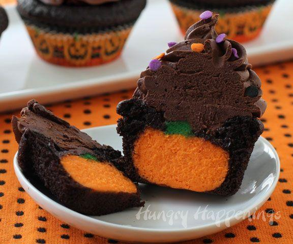 """<p>Surprise all of your guests with these chocolate cheesecake cupcakes that have a hidden pumpkin inside.</p><p><strong>Get the recipe at </strong><strong><a href=""""http://hungryhappenings.com/2013/09/ultimate-cheesecake-stuffed-Halloween-cupcakes.html/"""" rel=""""nofollow noopener"""" target=""""_blank"""" data-ylk=""""slk:Hungry Happenings"""" class=""""link rapid-noclick-resp"""">Hungry Happenings</a>.</strong></p><p><strong><a class=""""link rapid-noclick-resp"""" href=""""https://www.amazon.com/Wilton-Non-Stick-Muffin-Cupcake-Baking/dp/B00KIFBI1C/?tag=syn-yahoo-20&ascsubtag=%5Bartid%7C10050.g.1366%5Bsrc%7Cyahoo-us"""" rel=""""nofollow noopener"""" target=""""_blank"""" data-ylk=""""slk:SHOP CUPCAKE TINS"""">SHOP CUPCAKE TINS</a></strong></p>"""