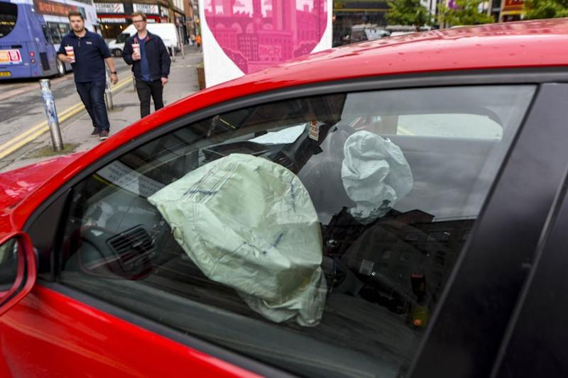 The airbags had been activated and the windscreen smashed however it appears the driver was safe enough to run off, leaving the car and the strange letter behind. Photo: Caters News