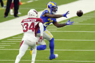 Los Angeles Rams running back Cam Akers, right, makes a catch in front of free safety Jalen Thompson (34) during the second half of an NFL football game Sunday, Jan. 3, 2021, in Inglewood, Calif. (AP Photo/Ashley Landis)