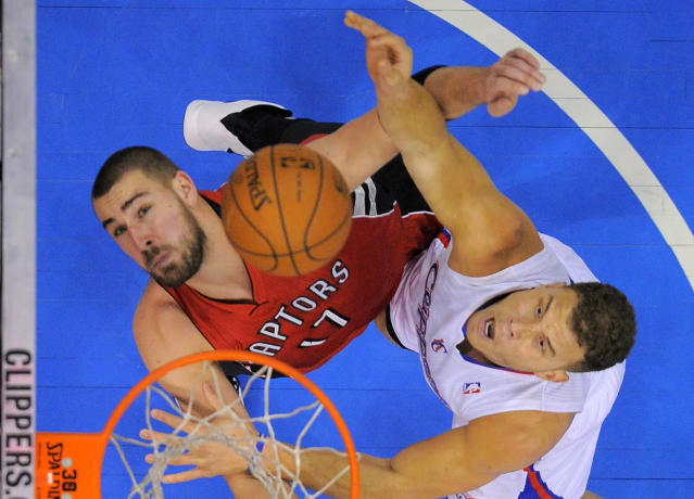 Los Angeles Clippers forward Blake Griffin, right, puts up a shot as Toronto Raptors center Jonas Valanciunas, of Lithuania, defends during the first half of an NBA basketball game, Friday, Feb. 7, 2014, in Los Angeles. (AP Photo/Mark J. Terrill)