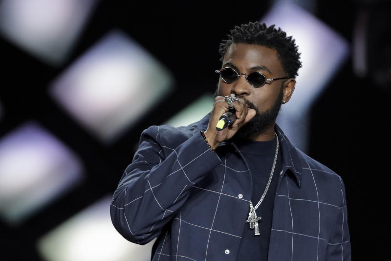 Belgian Congolese rapper William Kalubi aka Damso (L) celebrates after receiving the best rap album award during the 34th Victoires de la Musique, the annual French music awards ceremony, on February 8, 2019 at the Seine Musicale concert hall in Boulogne-Billancourt, on the outskirts of Paris. (Photo by Thomas SAMSON / AFP) (Photo credit should read THOMAS SAMSON/AFP via Getty Images)