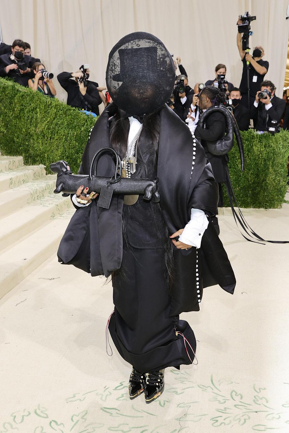 """<h1 class=""""title"""">Erykah Badu in Thom Browne</h1><cite class=""""credit"""">Photo: Getty Images</cite>"""