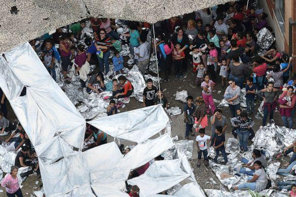 PHOTO: Migrants wait outside a makeshift encampment at the U.S. Border Patrol facility in McAllen, located close to the Central Processing Center where a suspected flu outbreak has prompted officials to stop processing, in McAllen, Texas, May 15, 2019. (Loren Elliott/Reuters)