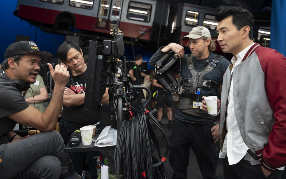 (L-R): Director Destin Daniel Cretton, fight instructor Alan Tang, crew camera operator, and Simu Liu on the set of Marvel Studios' SHANG-CHI AND THE LEGEND OF THE TEN RINGS. Photo by Jasin Boland. ©Marvel Studios 2021. All Rights Reserved.
