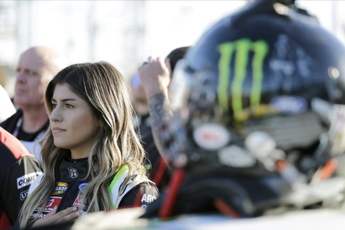 Hailie Deegan stands during the national anthem before the start of the ARCA auto race at Daytona International Speedway, Saturday, Feb. 8, 2020, in Daytona Beach, Fla. (AP Photo/Terry Renna)