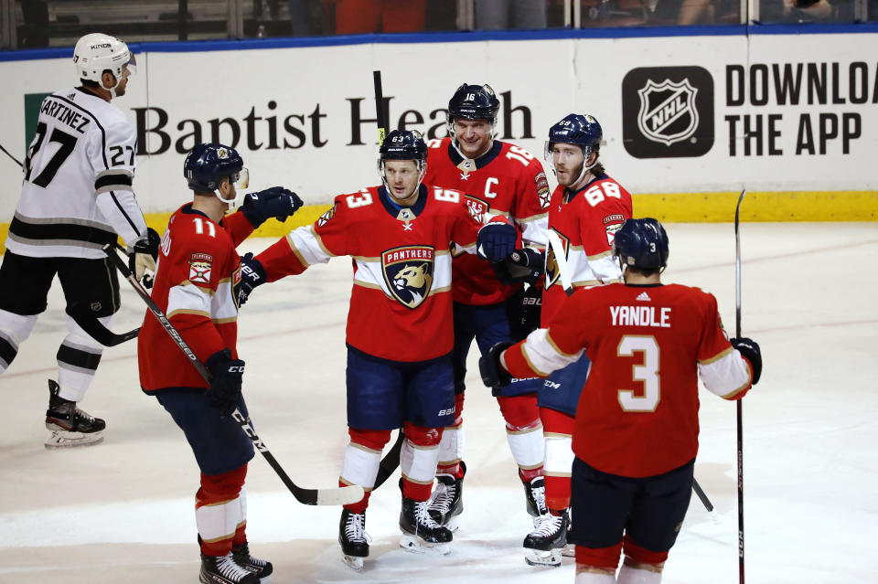 Florida Panthers right wing Evgenii Dadonov (63) celebrates with teammates after scoring during the first period of an NHL hockey game against the Los Angeles Kings, Thursday, Jan. 16, 2020, in Sunrise, Fla. (AP Photo/Brynn Anderson)