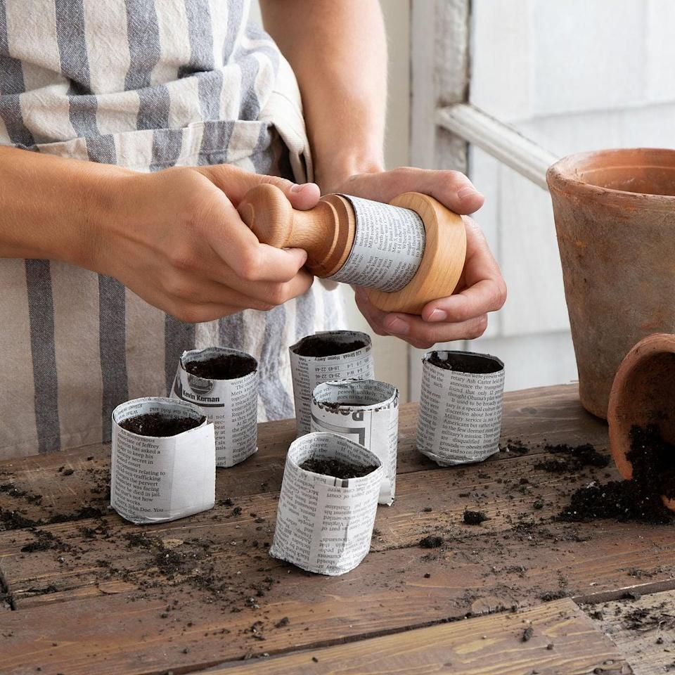 <p>This <span>Eco Gardener's Pot Press</span> ($26) is handy for repurposing old newspapers.</p>