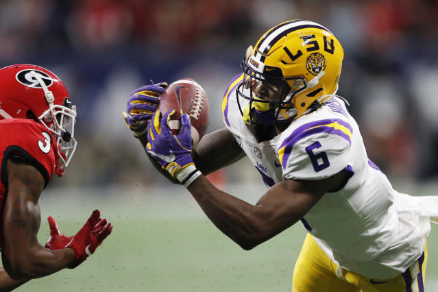 LSU wide receiver Terrace Marshall Jr. (6) makes the catch ahead of Georgia defensive back Tyson Campbell (3) during the first half of the Southeastern Conference championship NCAA college football game, Saturday, Dec. 7, 2019, in Atlanta. (AP Photo/John Bazemore)