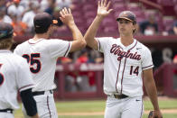 Virginia pitcher Brandon Neeck (14) high fives Griff McGarry (25) at the end of the eighth inning during an NCAA college baseball tournament super regional game against Dallas Baptist, Sunday, June 13, 2021, in Columbia, S.C. (AP Photo/Sean Rayford)