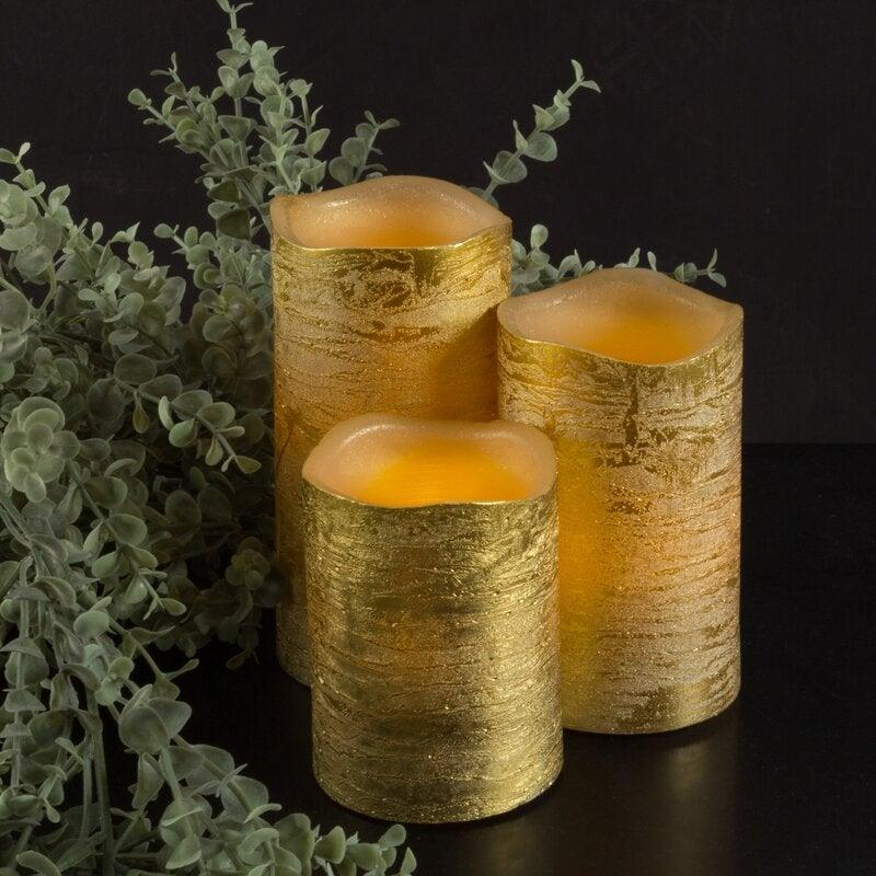 """<br><br><strong>House of Hampton</strong> 4 Piece Unscented Flameless Candle Set, $, available at <a href=""""https://go.skimresources.com/?id=30283X879131&url=https%3A%2F%2Fwww.wayfair.com%2Fdecor-pillows%2Fpdp%2Fhouse-of-hampton-4-piece-unscented-flameless-candle-set-lvrg2175.html"""" rel=""""nofollow noopener"""" target=""""_blank"""" data-ylk=""""slk:Wayfair"""" class=""""link rapid-noclick-resp"""">Wayfair</a>"""