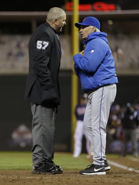 New York Mets manager Terry Collins, right, pleads his case with plate umpire Mike Everitt after Minnesota Twins' Justin Morneau was called safe on a play at home, scoring on a two-run single by Ryan Doumit in the fifth inning of a baseball game on Friday, April 12, 2013, in Minneapolis. (AP Photo/Jim Mone)