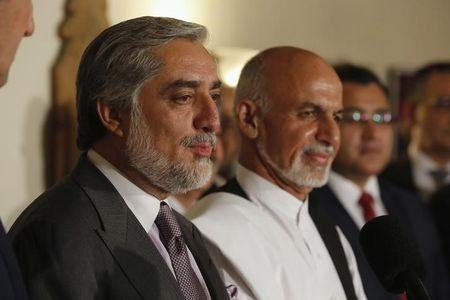 Afghanistan's presidential candidate Abdullah addresses a news conference with rival Ghani as they announced a deal for the auditing of all Afghan election votes at the United Nations Compound in Kabul