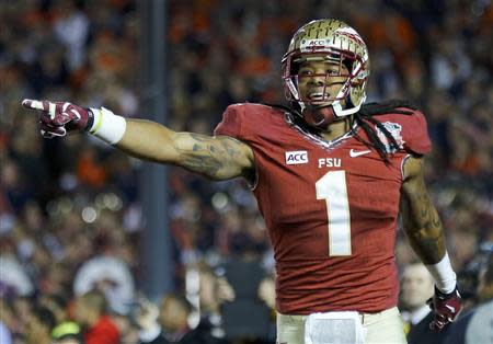 Florida State Seminoles Kelvin Benjamin celebrates after catching the game winning touchdown pass agasinst the Auburn Tigers in the fourth quarter during the BCS Championship football game in Pasadena, California January 6, 2014. REUTERS/Mike Blake