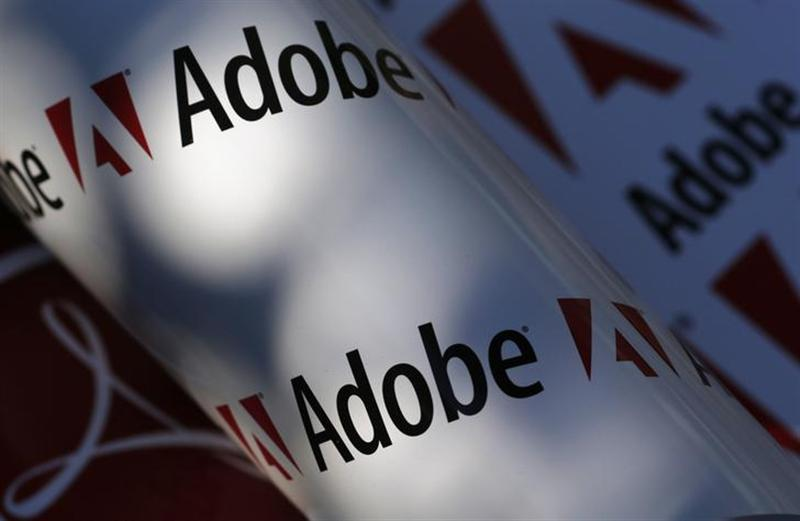 Adobe company logos are seen in this picture illustration taken in Vienna July 9, 2013. REUTERS/Leonhard Foeger/Files