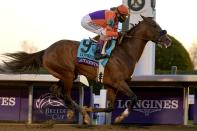 John Velazquez (9) rides Authentic to win the Breeder's Cup Classic horse race at Keeneland Race Course, in Lexington, Ky., Saturday, Nov. 7, 2020. (AP Photo/Michael Conroy)