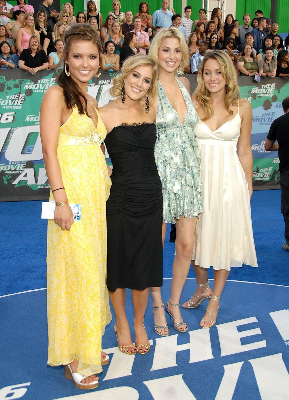 """<p>The original ladies of <a href=""""https://www.cosmopolitan.com/entertainment/celebs/a26411709/the-hills-cosmopolitan-cover-april/"""" rel=""""nofollow noopener"""" target=""""_blank"""" data-ylk=""""slk:MTV's soapy drama"""" class=""""link rapid-noclick-resp"""">MTV's soapy drama</a>, Audrina Patridge, Heidi Montag, Whitney Port, and Lauren Conrad, pose together at the 2006 MTV Movie Awards. For six seasons, cameras followed the sparkly 20-somethings and their v, v L.A. lives. </p>"""