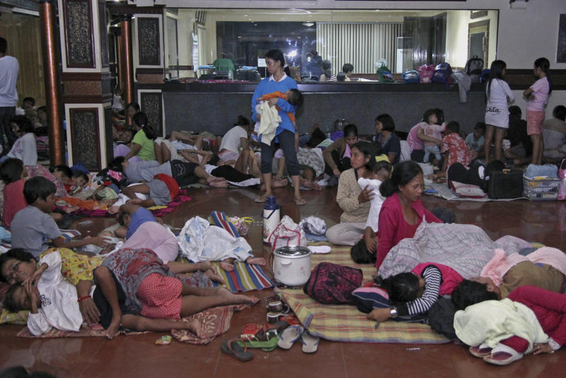 Residents take shelter at the lobby of the city hall in Tandag, Surigao Del Sur province in southern Philippines, following a 7.6 magnitude earthquake that struck eastern and southern Philippines Friday, Aug. 31, 2012. The quake set off car alarms, shook items off shelves and sent many coastal residents fleeing for high ground before the Pacific Tsunami Warning Center lifted all tsunami alerts it had issued for the Philippines and neighboring countries from Indonesia to Japan, and for Pacific islands as far away as the Northern Marianas. (AP Photo/Erwin Mascarinas)