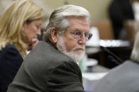 """FILE - In this Thursday, Sept. 17, 2020 file photo, Oklahoma state Sen. Roger Thompson, R-Okemah, listens during an Oklahoma Senate Public Safety Committee in Oklahoma City. In 2021, the new state budget is up nearly 18%. """"Last year: shaky foundation. This year: solid foundation,"""" said Republican state Sen. Roger Thompson, chairman of the chamber's budget-writing committee. (AP Photo/Sue Ogrocki, File)"""
