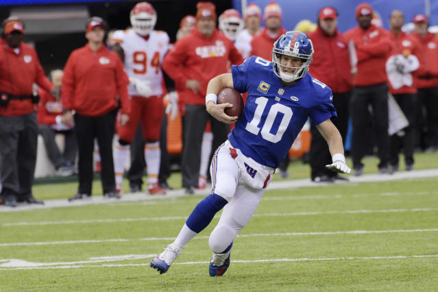 New York Giants quarterback Eli Manning rushes against the Kansas City Chiefs. (AP)