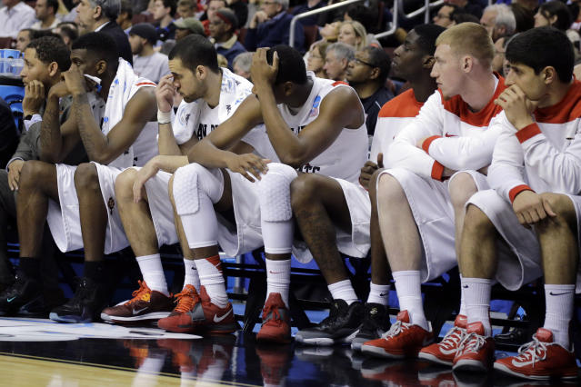 FILE - In this March 24, 2013, file photo, San Diego State players watch from the bench in the final minutes of a third-round game against Florida Gulf Coast in the NCAA college basketball tournament in Philadelphia. Florida Gulf Coast won 81-71. The high-flying FGSU Eagles and their showstopping offense earned their place in NCAA Tournament lore when, as a No. 15 seed in the South Region, they upset Georgetown and San Diego State in Philadelphia to reach the 2013 Sweet 16. (AP Photo/Matt Slocum, File)