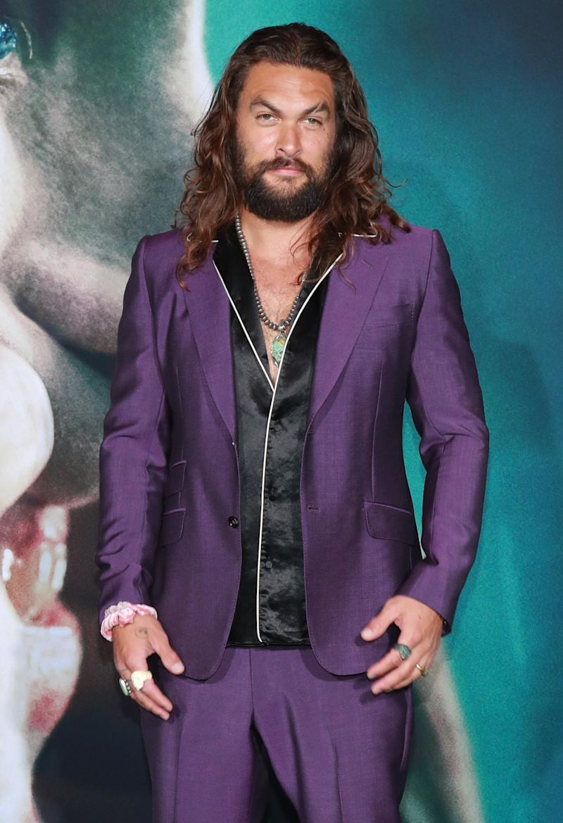 Momoa at the the premiere of the Joker wearing a scrunchie in September, 2019.