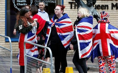 Supporters of the royal family stand outside the Lindo Wing of St Mary's Hospital - Credit: HENRY NICHOLLS /Reuters