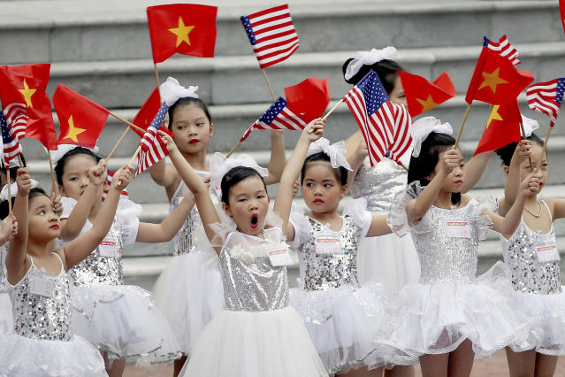 <p>Vietnamese children wave flags before a welcome ceremony of U.S. President Donald Trump at the Presidential Palace in Hanoi, Vietnam, Nov. 12, 2017. (Photo: Luong Thai Linh/AP) </p>
