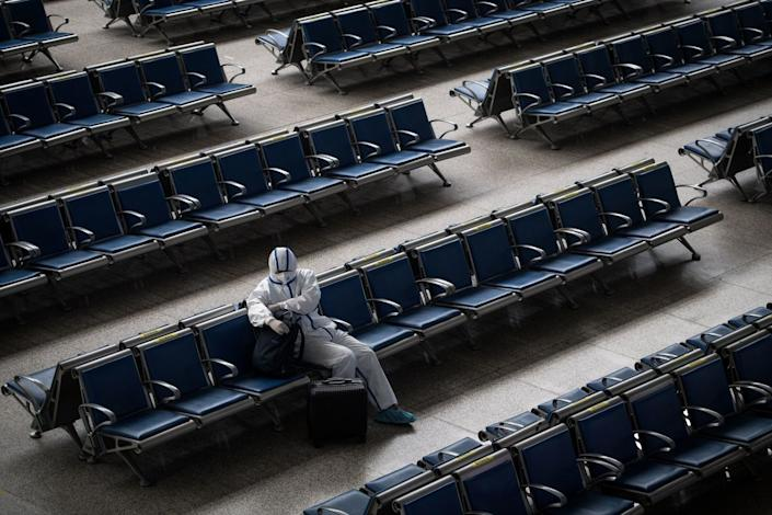 A passenger waits for a train at Hankou Railway Station in Wuhan, China, on May 2, 2020.