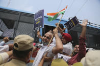 Members of National Students' Union of India (NSUI) are being detained and taken away by police during protest marking the second anniversary of Indian government scrapping Kashmir's semi- autonomy in Jammu, India, Thursday, Aug. 5, 2021. On Aug. 5, 2019, Indian government passed legislation in Parliament that stripped Jammu and Kashmir's statehood, scrapped its separate constitution and removed inherited protections on land and jobs. (AP Photo/Channi Anand)
