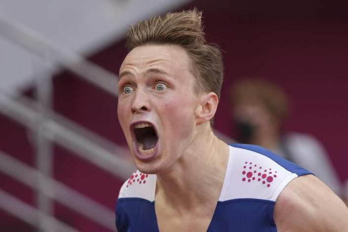 Karsten Warholm, of Norway, celebrates after winning the gold medal in the men's 400-meter hurdles at the 2020 Summer Olympics, Tuesday, Aug. 3, 2021, in Tokyo.(AP Photo/David J. Phillip)