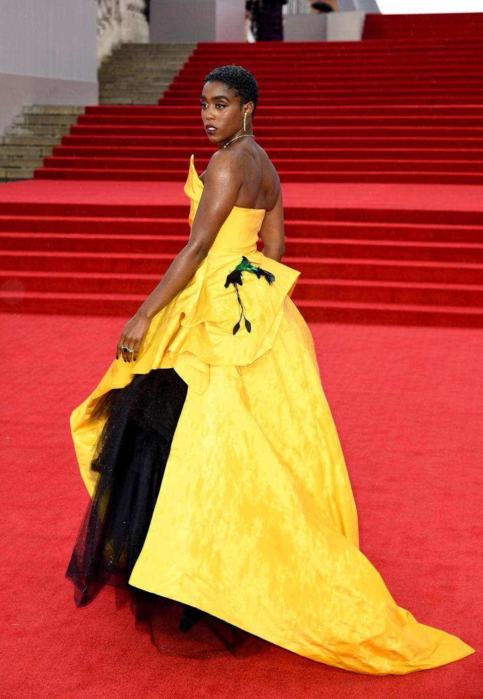 """<p>Lashana Lynch, who <a href=""""https://www.harpersbazaar.com/uk/culture/culture-news/a34517814/lashana-lynch-black-female-007-interview/"""" rel=""""nofollow noopener"""" target=""""_blank"""" data-ylk=""""slk:plays the first Black female 007"""" class=""""link rapid-noclick-resp"""">plays the first Black female 007</a>, wore a dramatic Vivienne Westwood couture gown with a mixture of jewellery by Ara Vartanian, Shaun Leane and Jessica McCormack. </p>"""