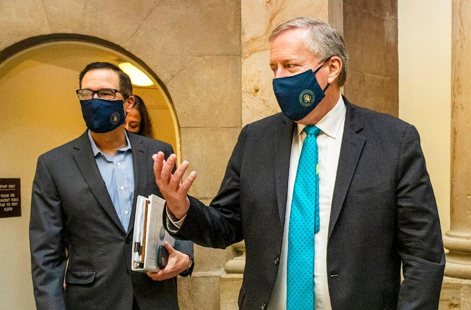 White House chief of staff Mark Meadows, right, and Treasury Secretary Steven Mnuchin arrive at the office of House Speaker Nancy Pelosi at the Capitol to resume talks on a COVID-19 relief bill Aug. 1 in Washington.