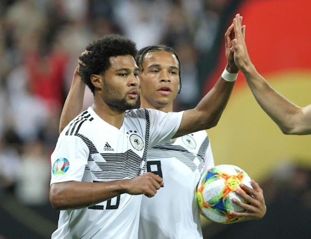 Germany winger Serge Gnabry (L) scored twice in June's 8-0 win over Estonia, but expects a tough away game in Tallinn in Sunday's Euro 2020 qualifier. (AFP Photo/Daniel ROLAND)