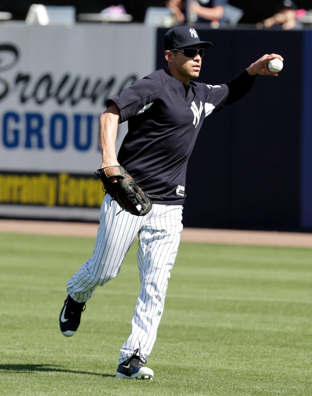 FILE - In this Feb. 19, 2018, file photo, New York Yankees' Jacoby Ellsbury works on a drill at spring training baseball camp in Tampa, Fla. Ellsbury's latest ailment is plantar fasciitis, preventing the Yankees outfielder from fully resuming baseball activities. (AP Photo/Lynne Sladky, File)