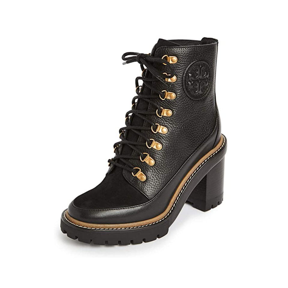 """We've raved about <a href=""""https://www.glamour.com/gallery/lug-sole-boots?mbid=synd_yahoo_rss"""" rel=""""nofollow noopener"""" target=""""_blank"""" data-ylk=""""slk:lug sole boots"""" class=""""link rapid-noclick-resp"""">lug sole boots</a> before, and the internet-famous style has been spotted on everyone from Kendall Jenner to Hailey Bieber. This lace-up pair from Tory Burch adds an elevated touch to a standard combat boot, thanks to gold accents, ice skate-style lacing, and a block heel. $458, Amazon. <a href=""""https://www.amazon.com/Tory-Burch-Womens-Booties-Perfect/dp/B08DHWB12K/ref=sr_1_1?dchild=1&keywords=Tory+Burch+boots&qid=1631119784&sr=8-1"""" rel=""""nofollow noopener"""" target=""""_blank"""" data-ylk=""""slk:Get it now!"""" class=""""link rapid-noclick-resp"""">Get it now!</a>"""