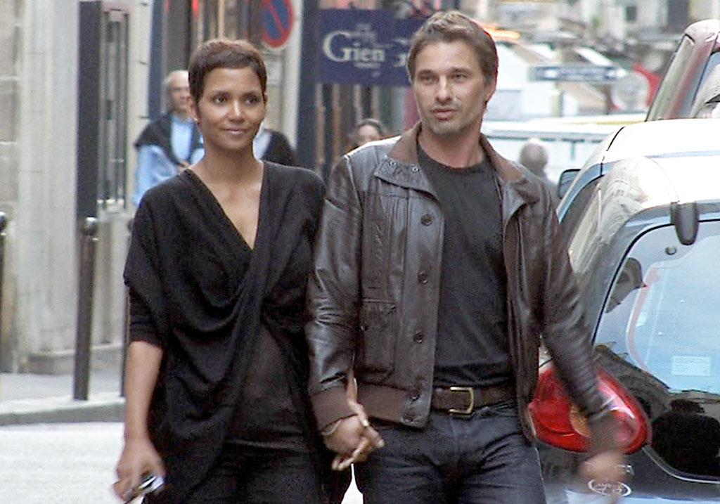"""Flaunting their happiness for the whole world to see, Halle Berry and her """"Dark Tide"""" co-star Olivier Martinez, both 44, held hands while talking a romantic walk in the St. Germain neighborhood of Paris. The new couple were also spotted kissing and cuddling. Cute! <a href=""""http://www.x17online.com"""" target=""""new"""">X17 Online</a> - September 5, 2010"""