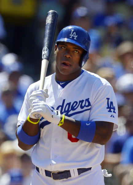Los Angeles Dodgers' Yasiel Puig reacts to an intentional walk during the fifth inning of the Dodgers' baseball game against the Tampa Bay Rays, Saturday, Aug. 10, 2013, in Los Angeles. (AP Photo/Mark J. Terrill)