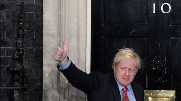 Britain's Prime Minister Boris Johnson gestures as he arrives at 10 Downing Street