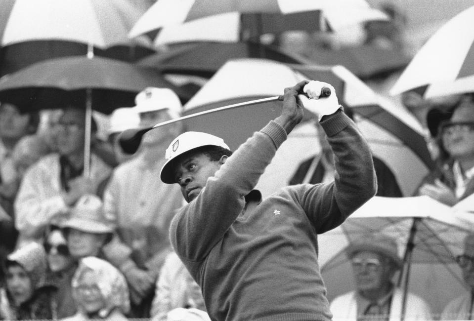 FILE - Lee Elder watches the flight of his ball as he tees off in the first round of play at the Masters in Augusta, Ga., in this April 10, 1975, file photo. Elder was already 40 years old when he made history as the first Black player to tee off at the Masters, so many of his prime years squandered by the scourge of racism. (AP Photo/File)