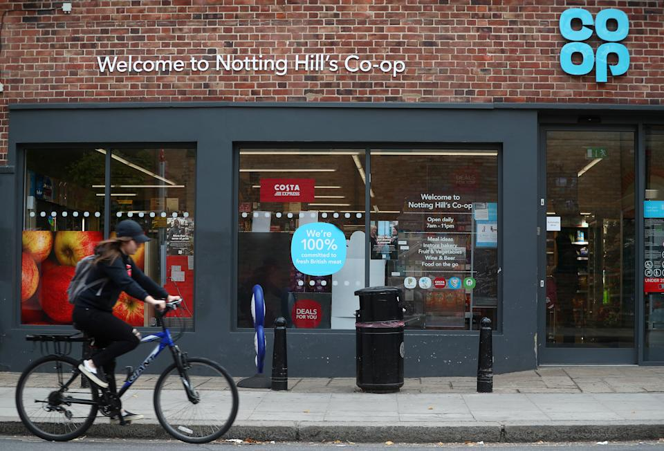 A woman cycles past a Co-op supermarket in London, Britain, September 14, 2018. REUTERS/Hannah McKay