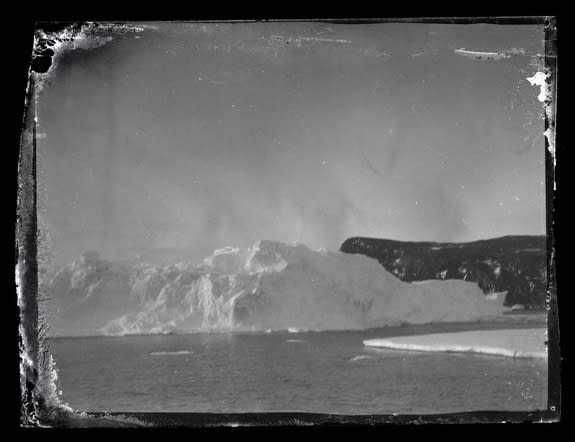 An iceberg and land at Ross Island, Antarctica in a photograph taken between 1914 and 1917 and only recently developed.