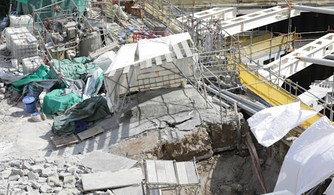 Cracks and sinkholes appear at a construction site for the Lyric Theatre Complex in the West Kowloon Cultural District. Photo: May Tse